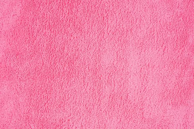 Priorità bassa di struttura del tessuto vintage macro rosa astratto