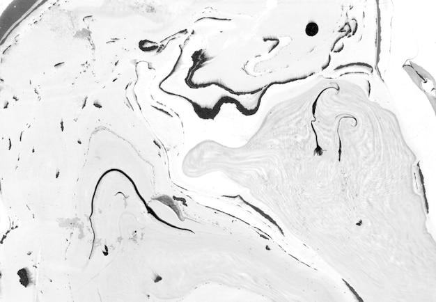 Priorità bassa di marmo astratta. carta e mix di inchiostro fluente. mix di colori grigio e nero.