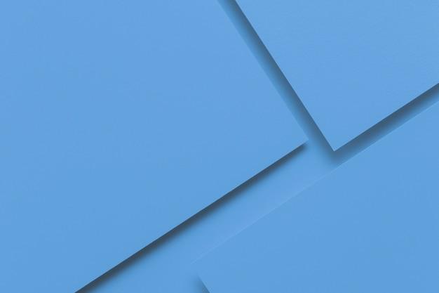 Priorità bassa di struttura di carta creativa monocromatica astratta. minime forme geometriche e linee in colore azzurro