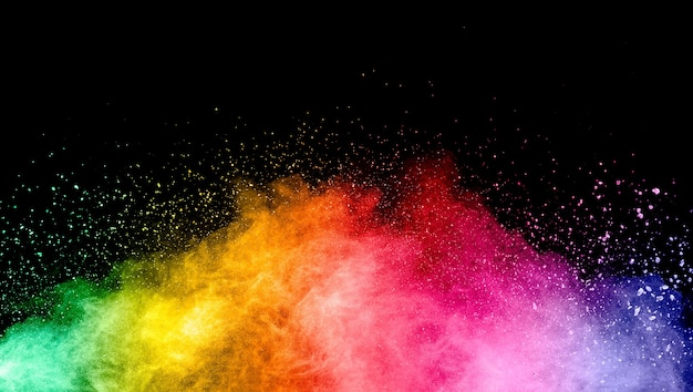Esplosione astratta di polvere multicolore su sfondo nero.