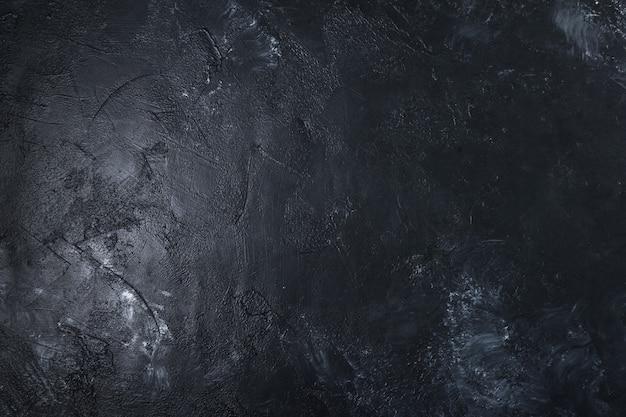 Vecchia struttura grungy astratta, fondo d'annata della parete di cemento grigio scuro. posto per testo e pubblicità. struttura della superficie in calcestruzzo con un'area graffiata esposta all'aria per lo sfondo o la decorazione.