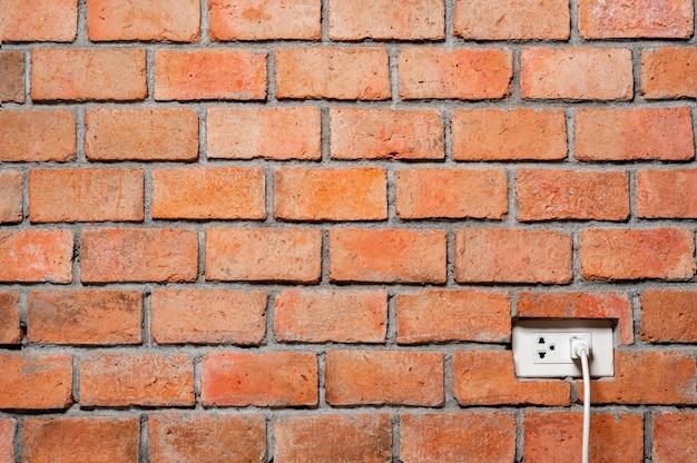 Muro di mattoni arancione astratto con priorità bassa di struttura della spina di alimentazione