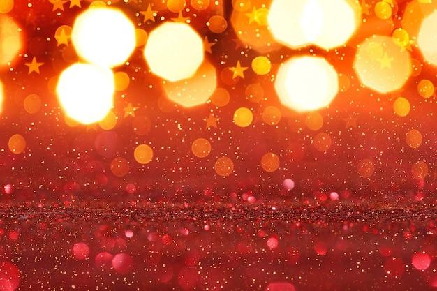 Sfondo astratto glitter rosso con luci d'oro