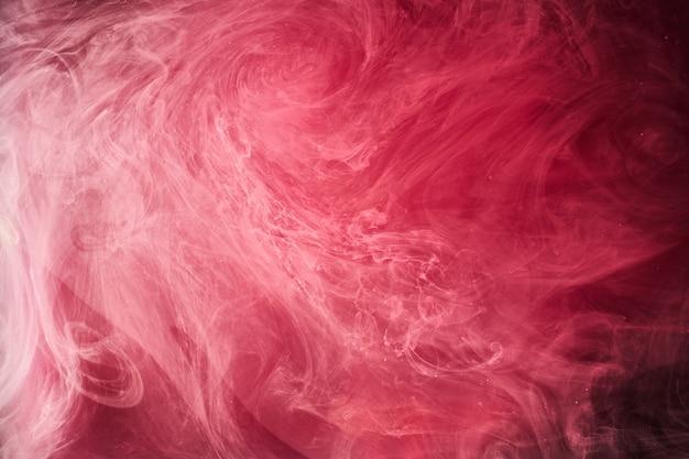 Fondo rosso astratto dell'oceano, pitture di rubino in acqua, carta da parati scarlatta del fumo luminoso vibrante