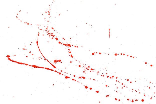 Priorità bassa rossa astratta della spruzzata della vernice dell'acquerello. spruzzata dell'acquerello rosso isolato su bianco