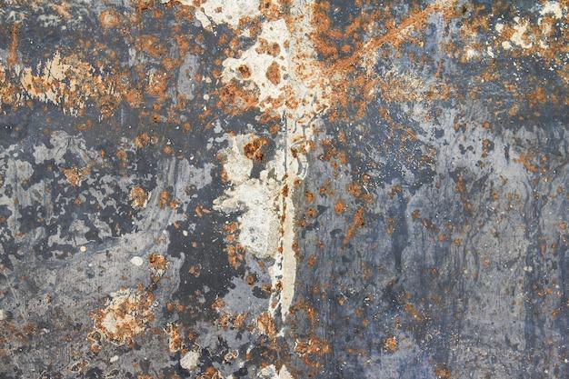 Muro di metallo grungy arrugginito astratto