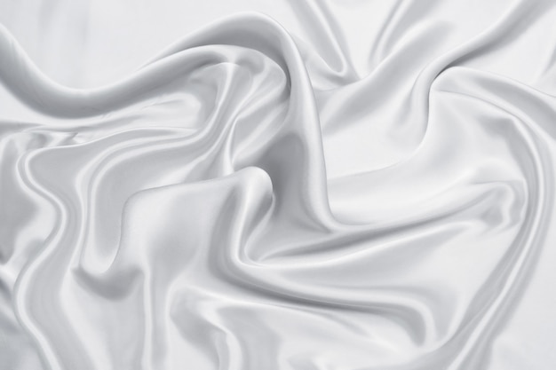 Tessuto bianco liscio astratto di seta o texture satinata