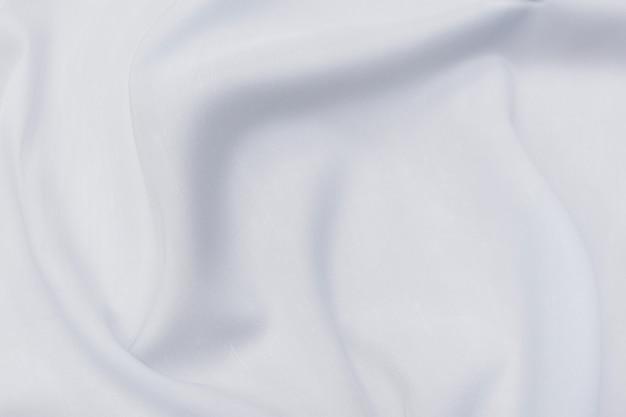Onda astratta e soft focus di sfondo in tessuto bianco o avorio, trama bianca e dettaglio
