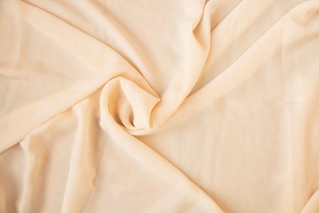 Tessuto di seta di lusso di superficie astratta, pieghe ondulate del fondo di struttura di seta di lerciume
