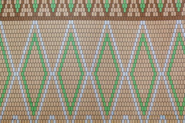 Texture astratta con mazayka di plastica sul muro