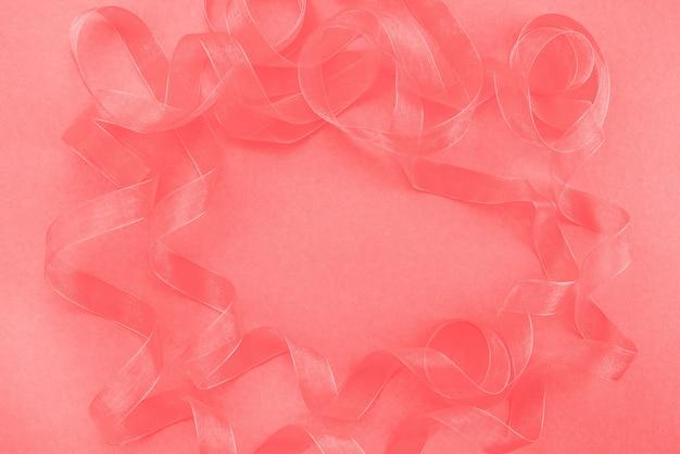 La priorità bassa di corallo strutturata astratta ribbon ricce la vista superiore