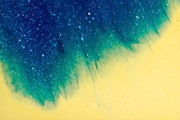 Priorità bassa strutturata astratta della melma gialla e blu