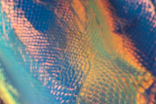 Fondo olografico alla moda astratto con i colori al neon. sfondo per il tuo design.