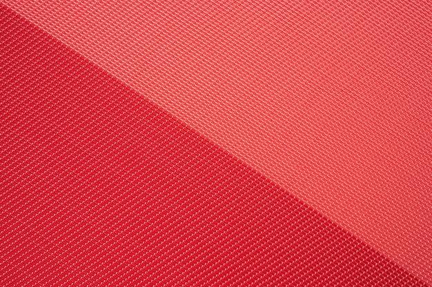 Fondo rosso astratto di struttura del tessuto di due toni