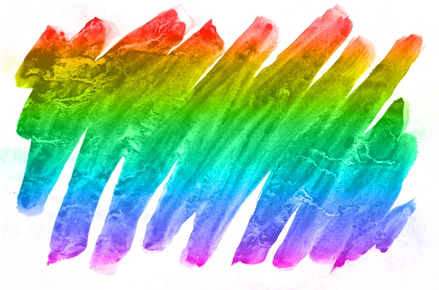 Acquerello astratto di macchie di inchiostro multicolore di tutti i colori spettrali. immagine di sfondo fatta con gli acquerelli in una soluzione di colore dell'arcobaleno