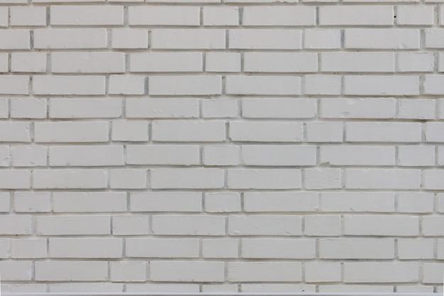 Struttura stagionata astratta macchiata vecchio stucco grigio chiaro e vernice invecchiata sfondo muro di mattoni bianchi in camera rurale, blocchi arrugginiti grungy di pietra tecnologia colore architettura orizzontale carta da parati