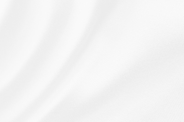 Fondo bianco astratto della sfuocatura di struttura del panno del tessuto