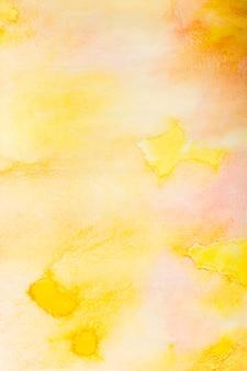 Priorità bassa gialla astratta dell'acquerello