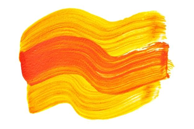 Tratti di pennello arancioni gialli astratti isolati su sfondo bianco