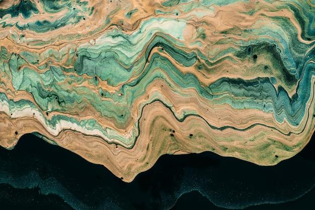 Arte fluida acrilica. onda dorata e verde. effetto marmorizzato di lusso.
