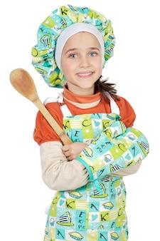 Adorabile futuro cuoco su uno sfondo bianco