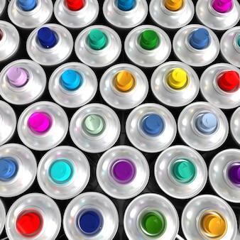 Vista aerea di bombolette aerosol disposte in modo ordinato con ugelli colorati diversi