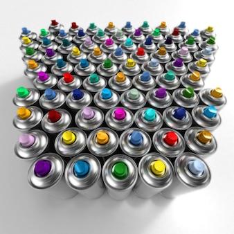Vista aerea di bombolette aerosol disposte in modo ordinato con diversi ugelli colorati