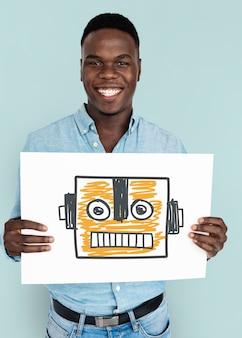 Le mani dell'uomo di origine africana tengono un simbolo del robot