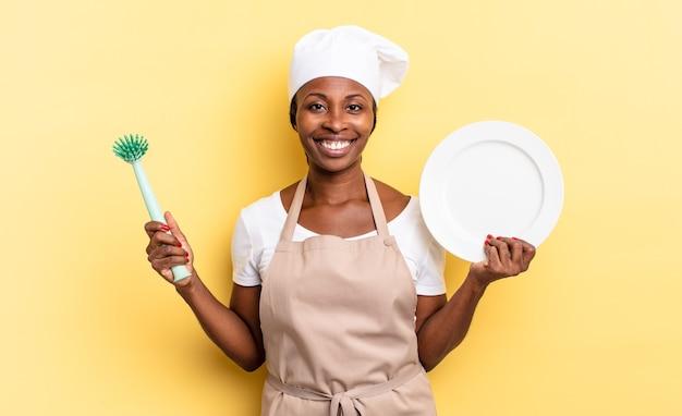 Afro nero bella donna che lava i piatti concept