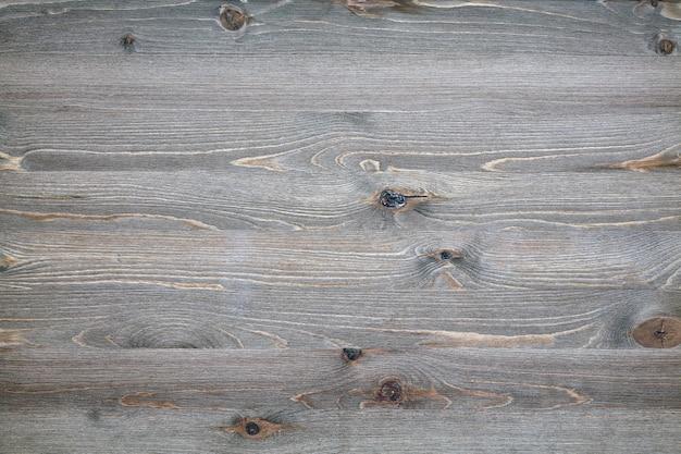 Piano in legno invecchiato con nodi e crepe