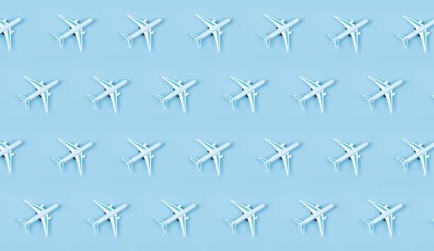 Modello in miniatura di aeroplano su sfondo blu
