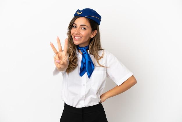 Hostess aereo su sfondo bianco isolato felice e contando tre con le dita