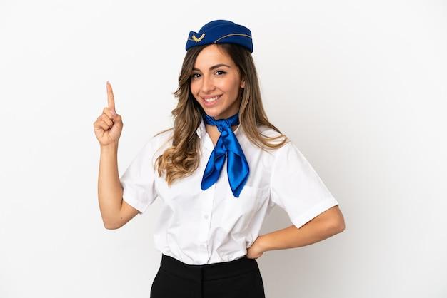Hostess aereo isolato su sfondo bianco che mostra e alzando un dito in segno del meglio