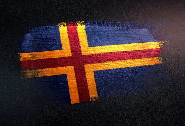 Bandiera delle isole aland fatta di vernice pennello metallico sulla parete scura del grunge