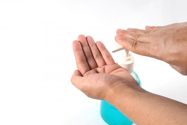Lavaggio della mano del gel dell'alcool sul bianco isolato