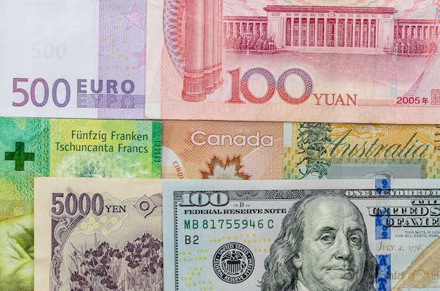 Banconota dollaro australiano americano canadese americano, euro, yen giapponese e yuan cinese