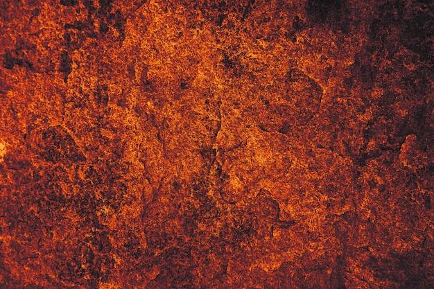 Superficie scura della pietra del granito della lava scura della caverna per l'interno