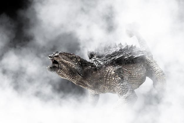 Dinosauro ankylosaurus su sfondo di fumo