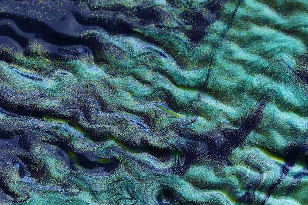 Struttura delle onde di aqua menthe. sfondo glitter turchese. struttura macro blu-verde