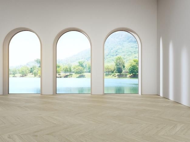 Finestra ad arco vicino al muro di cemento bianco sul pavimento in parquet di legno vuoto del soggiorno luminoso