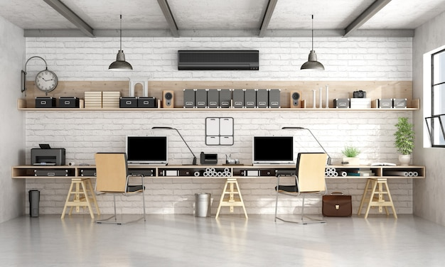 Ufficio sul posto di lavoro di architettura o ingegneria con due postazioni di lavoro in un loft