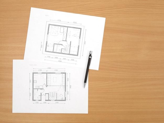 La planimetria dell'architettura su carta si trova sul tavolo con struttura in legno