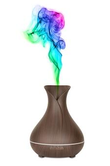Concetto di aromaterapia. diffusore e umidificatore dell'aroma dell'olio essenziale elettrico in legno con vapore colorato su sfondo bianco