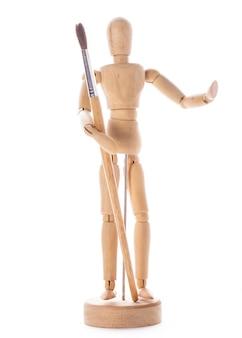 Concetto di arte, figura in legno per modellare pose di umani e pennello