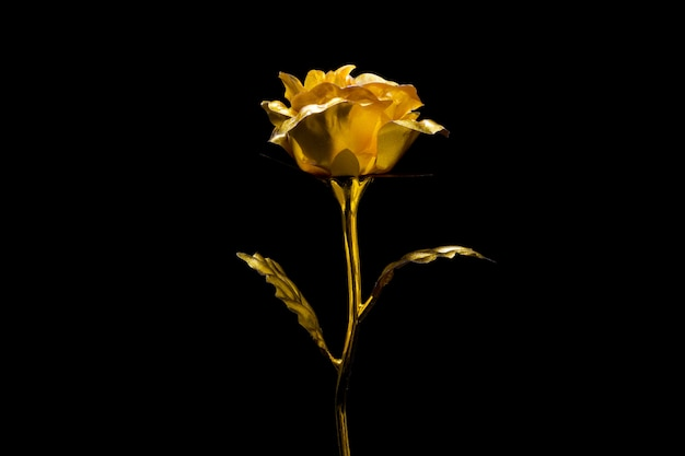 Rosa dorata artificiale su fondo nero.