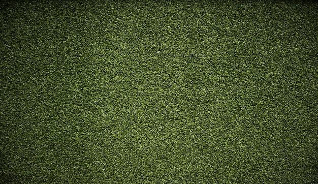 Trama di sfondo erba verde artificiale.