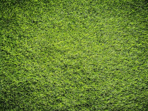 Fondo artificiale di struttura dell'erba verde.