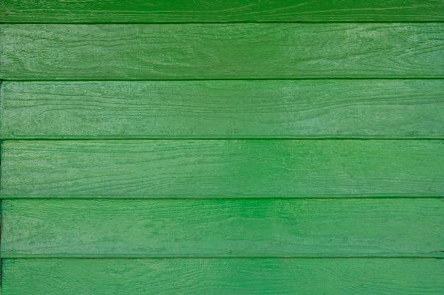 Sfondo di muro di legno verde artificiale