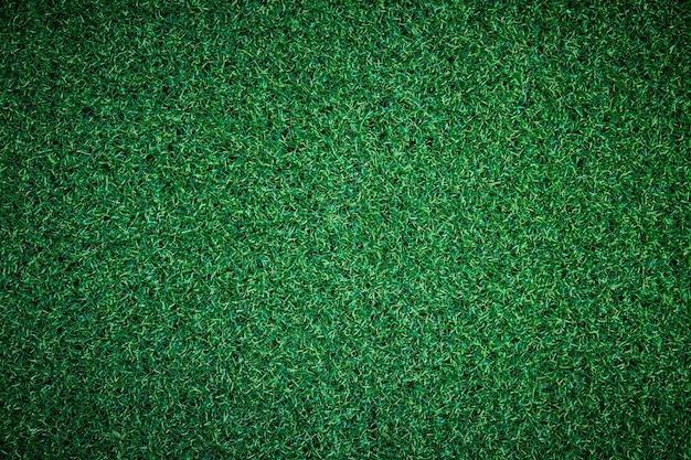 Erba artificiale o trama di erba verde può essere utilizzata come sfondo