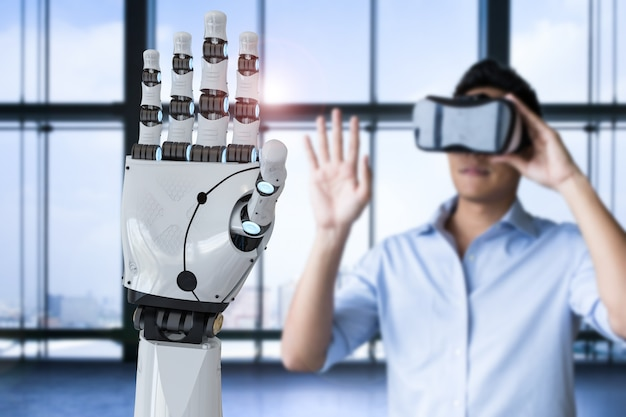 Uomo asiatico che indossa la cuffia vr e controlla la mano del robot di rendering 3d